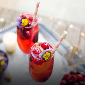 Elderflower lemonade with frozen berries