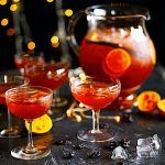 christmas drinks with cinnamon sticks and citrus fruit sliced