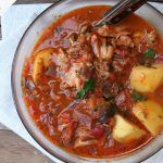 potatoes in a stew with meat and vegetables