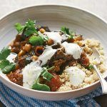 vegetarian aubergine tagine with cous cous and sour cream on top