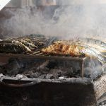fish being smoked and grilled