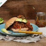 sloppy joes vegan burger with vegan chilli, avocado in a bun