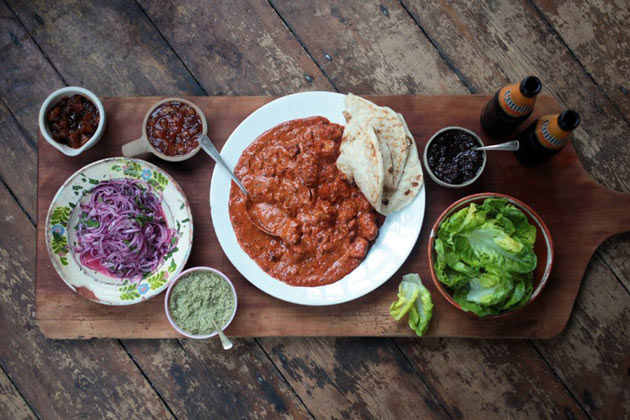 butter chicken curry recipe with naan bread and salad on the side