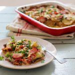 potato gratin with cheese and bacon and coriander on top