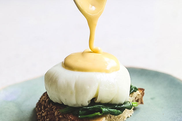 perfect hollandaise sauce on top of poached egg on toast