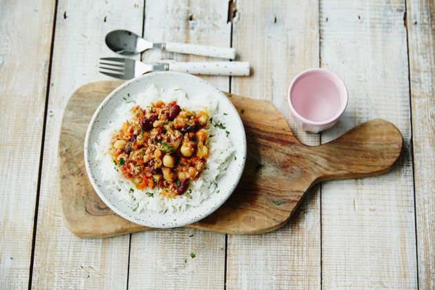 family meals - rice and chilli with a cup of water