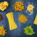 an array of different pasta shapes and colours