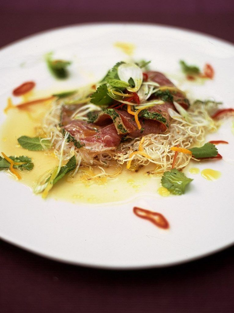 Citrus seared tuna with crispy noodles herbs and chilli