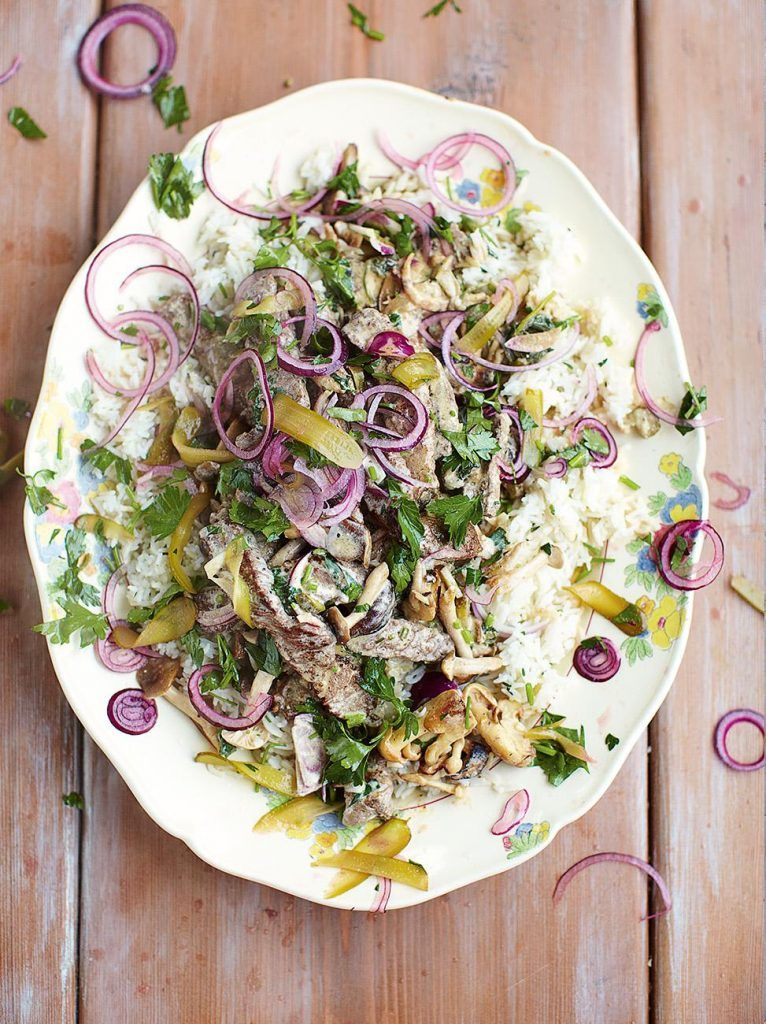 Beef stroganoff fluffy rice, red onion and parsley pickle