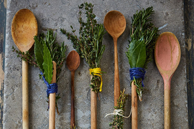 herb brush attached to wooden spoons