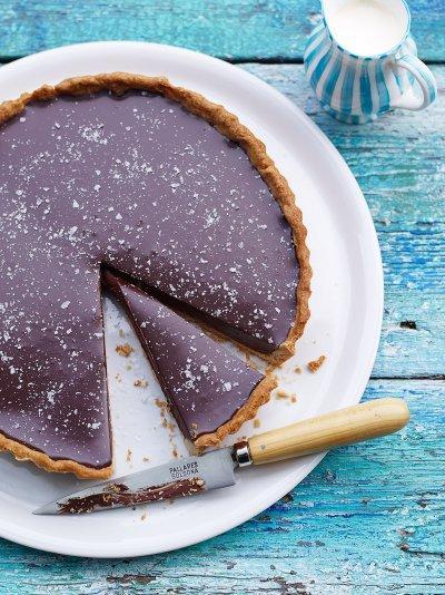 Rich chocolate tart with salt flakes