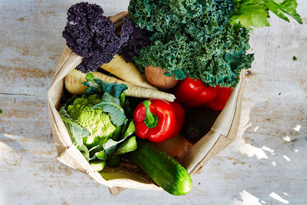 reusable bag filled with fresh produce and vegetables