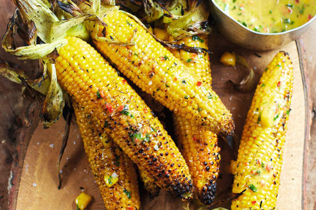 corn on the cob covered in marinade and sauce