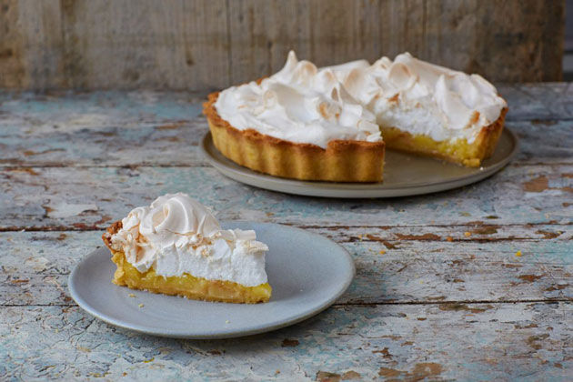 lemon meringue pie with a slice cut out of it
