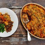 vegan shephards pie dish with veg on the side