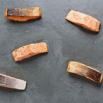 scattered pieces of salmon for salmon recipes
