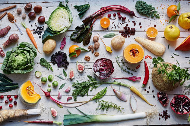 flat lay of vegetables on a white wooden table