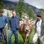 jamie with farmers and the cows