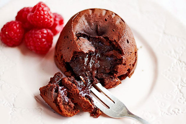 chocolate fondant pudding with raspberries on the side