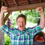 Foods to boost exercise - Jamie raising hands in air looking excited