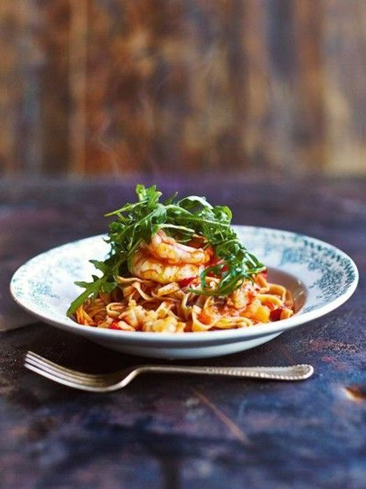 prawn linguine with herbs on top