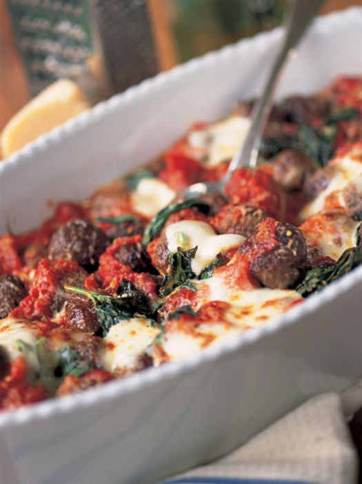 meatballs with cheese and veg in a dish
