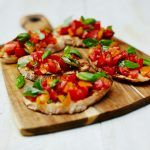 vegan summer recipe feature - tomato bruschetta with basil on top
