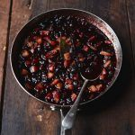 A pan of cranberry sauce on a wooden table