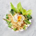 Veggie pad Thai in a bowl with an egg on top. A perfect recipe to help reduce food waste