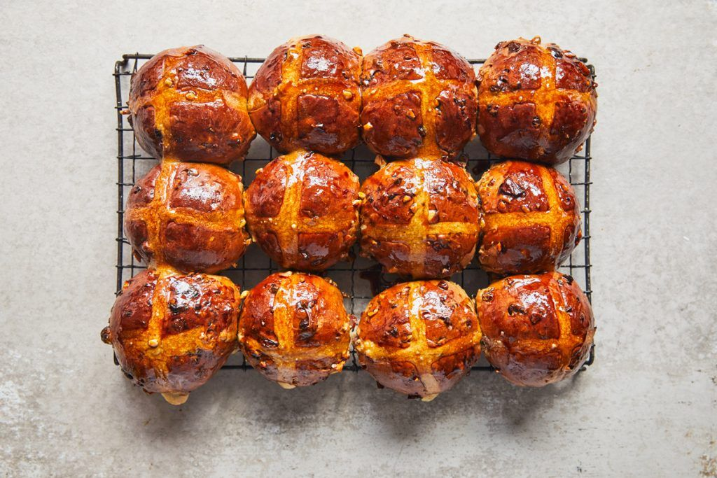 12 hot cross buns on a cooling rack