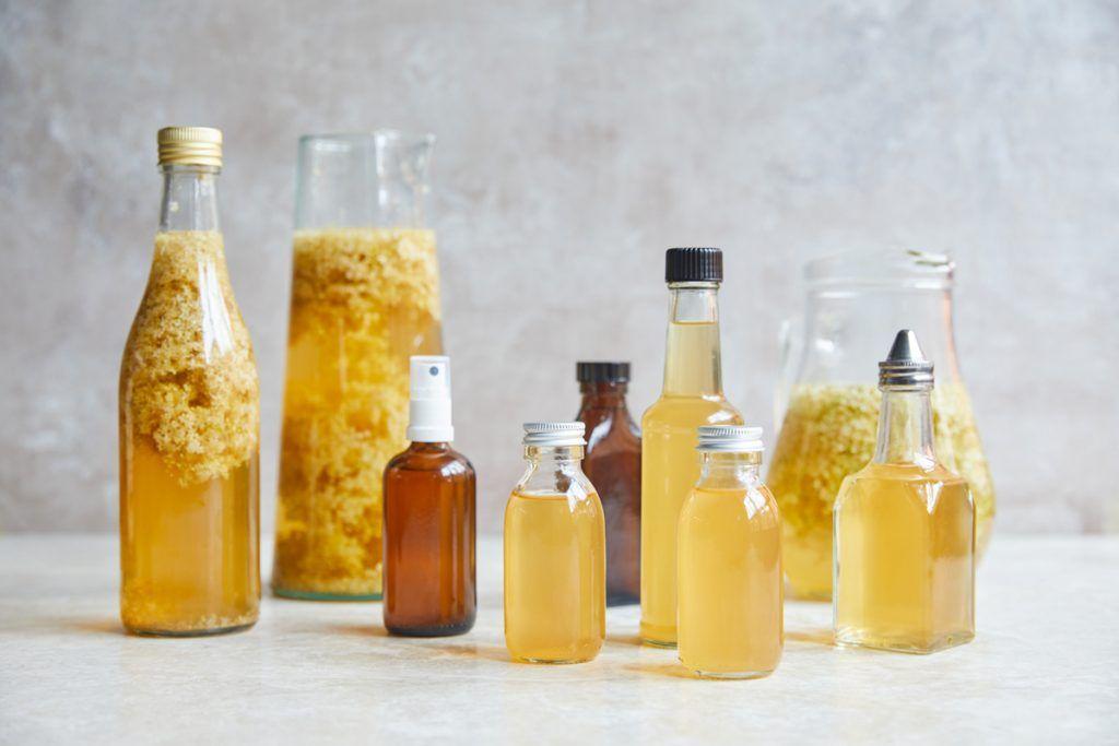 Elderflower vinegar in bottles and jars
