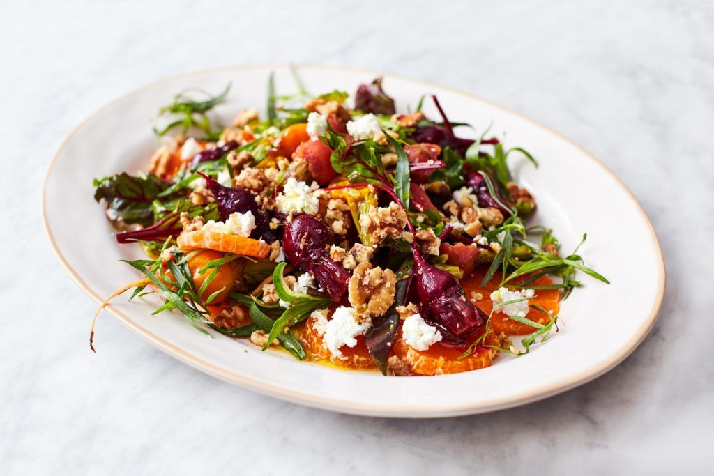 Beetroot recipes - Colourful, dressed beetroot salad on a white plate