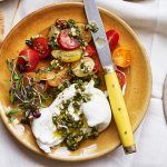 Summer recipes - beautiful burrata on a plate with tomatoes and pesto