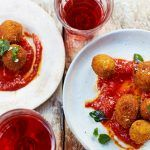Fried olive tapas with tomato sauce