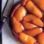 Pear recipes - a pear tart on a plate with a knife next to it
