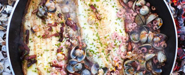 sole and clams cooked in a pan with shrimp