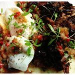 poached eggs on flatbread with meat and veg