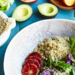 quinoa with salad and avocado in a bowl