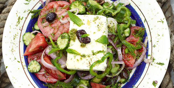 greek salad with cheese, olives, tomatoes and herbs
