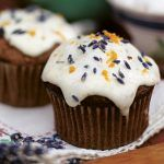 cupcakes with icing on top and lavender with orange zest