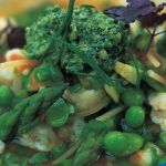 fresh vegetables in a winter soup with asparagus and peas