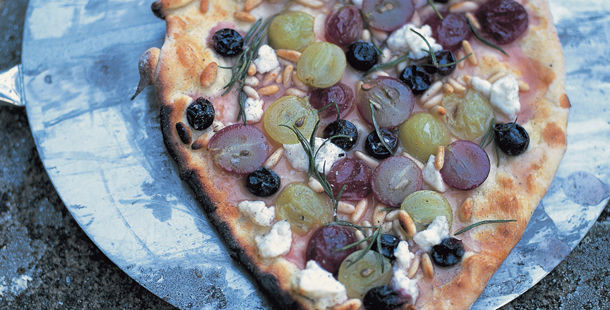 vegetarian pizza with feta, olives and pine nuts
