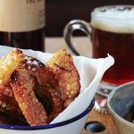 pork crackling with apple sauce next to beer
