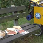 sandwich slices with ham on top outside in a park