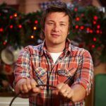 jamie oliver at christmas with christmas decorations behind him
