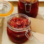 christmas chutney in mason jar with labels next to it
