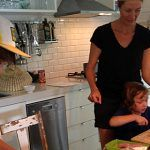 family cooking in a kitchen together