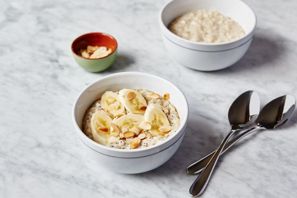 oatmeal porridge with seeds, nuts and banana on top