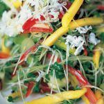 salad with shredded veg and cheese on top