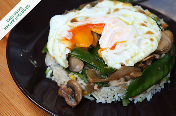poached egg on rice and mushroom veggie stir fry dish